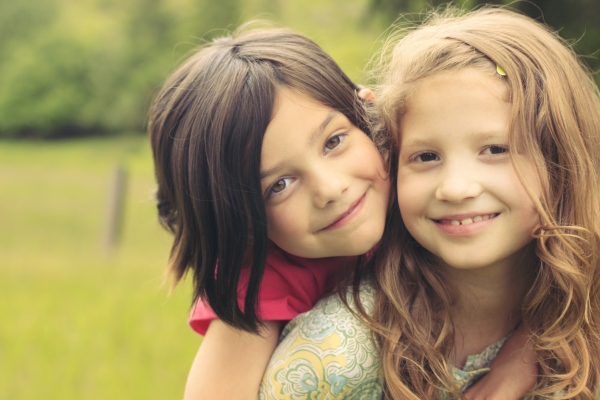 Two young girls smiling in North Yorkshire.