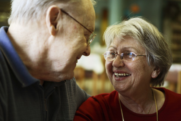 Older couple smiling at each other in North Yorkshire.