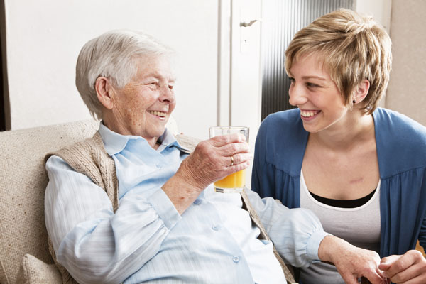 Older woman and carer talking in North Yorkshire.