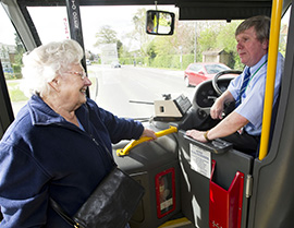 Older lady talking to bus driver