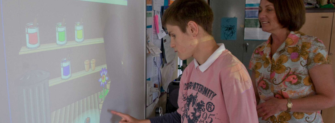 Student using touch screen board in school in North Yorkshire.