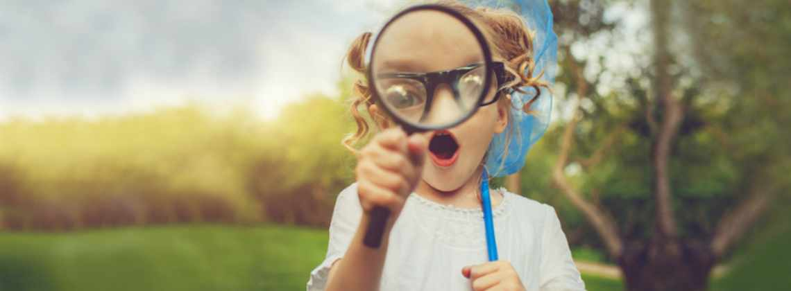 Girl with a magnifying glass looking for the next Assistant Director; Education and Skills