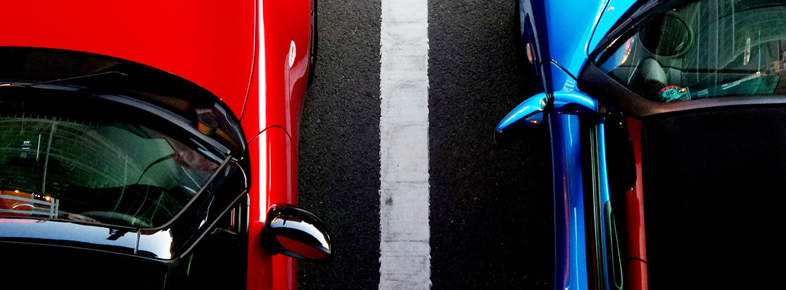 Red and blue cars parked.