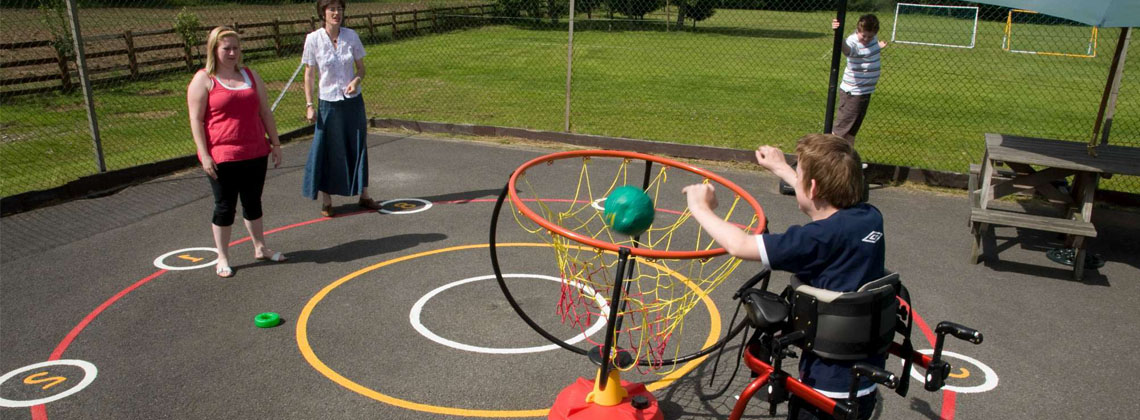 Young person in a wheelchair playing outside in North Yorkshire.