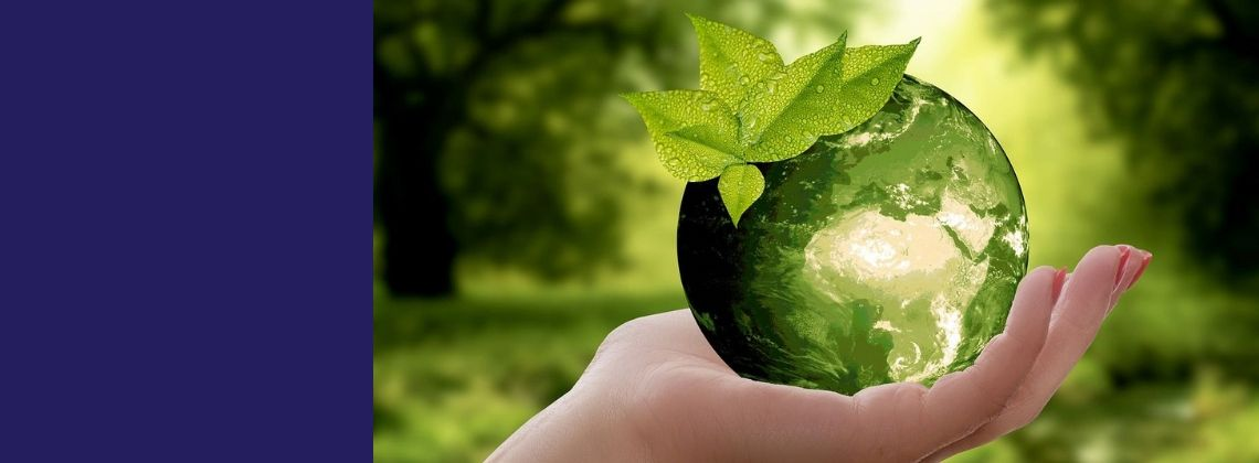 green planet on a hand