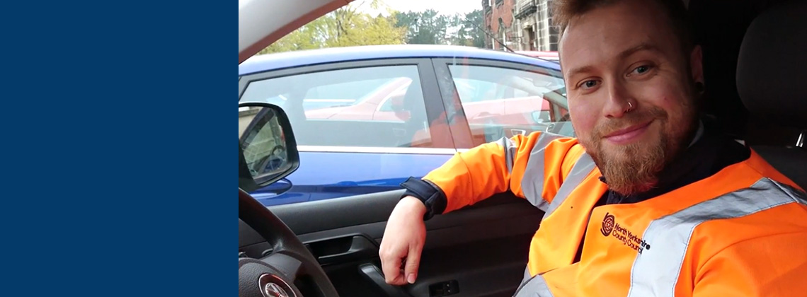 Highways worker sat in car