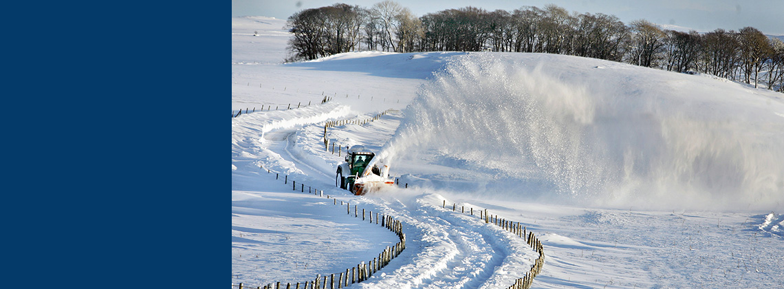 Snow plough clearing a road