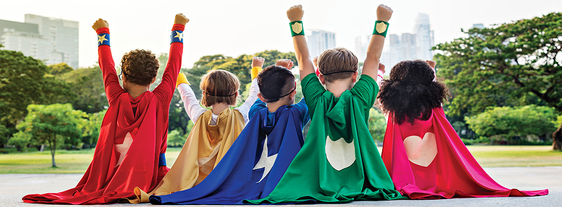 Row of children dressed as super heroes