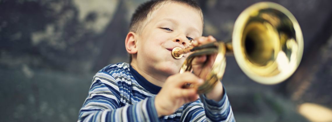 Boy playing the trumpet