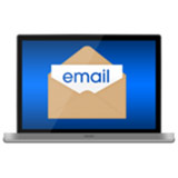 A laptop showing an email symbol