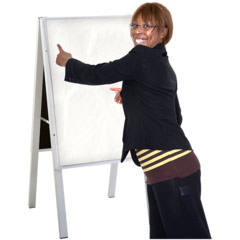 Lady standing in front of whiteboard.