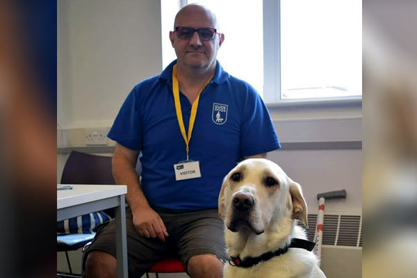 Antonio with guide dog