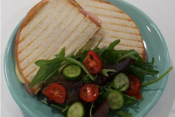 Toasted sandwich with salad from Creative Coffee Shop.