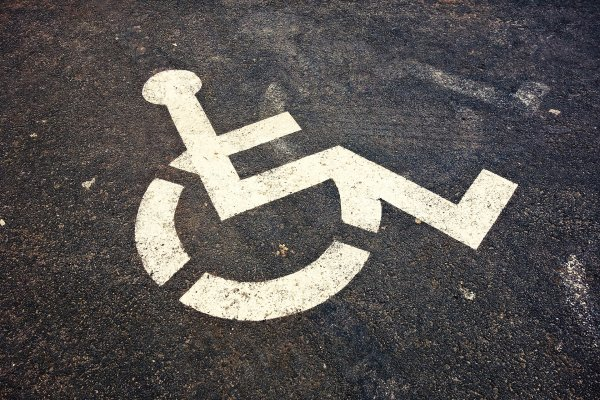 A disabled sign in a parking space at work.