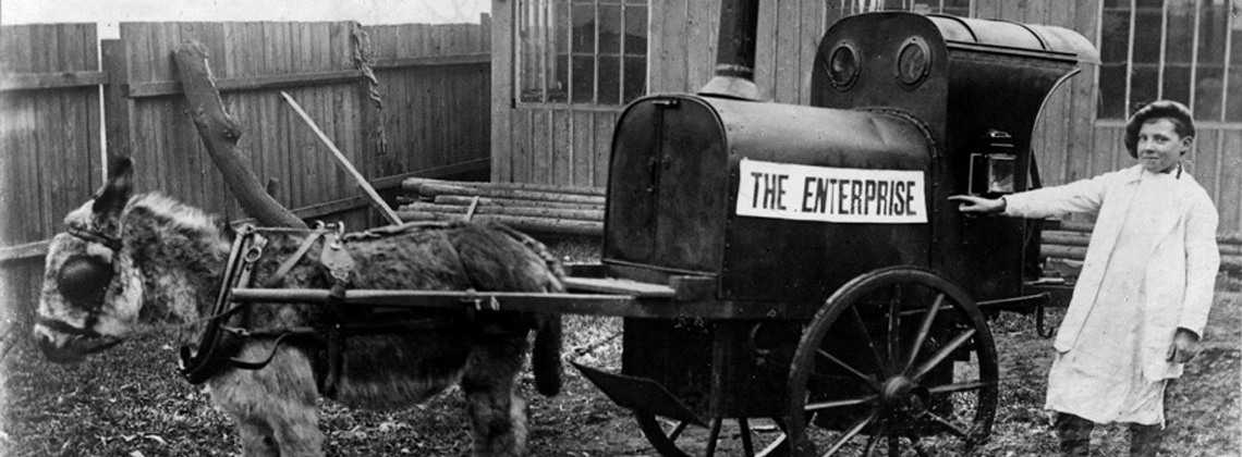 A boy with cart and donkey in the collection of North Yorkshire County Record Office.