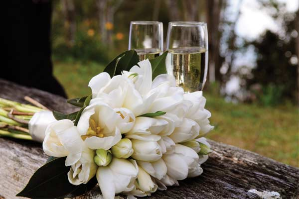 Flowers and champagne at wedding venue The Feathers Hotel in North Yorkshire