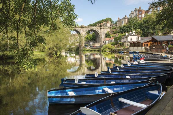 River and boats in the summer in Knaresborough North Yorkshire.
