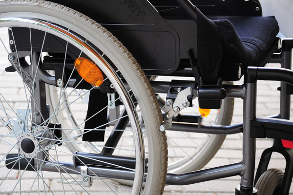 A close up of the wheel of a wheelchair representing accessibility in North Yorkshire.