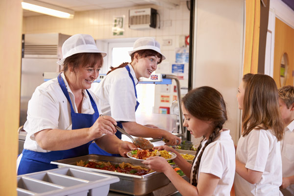 Pupils being served school meals