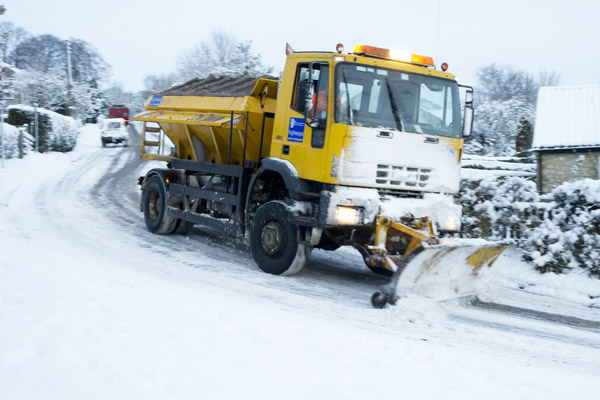 Snowplough clearing snow which causes school closures