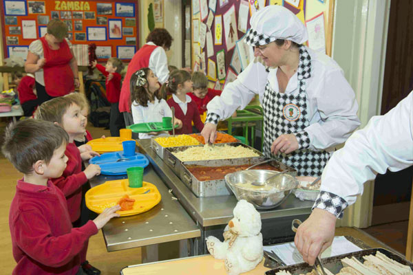 Primary school pupils getting their school meals
