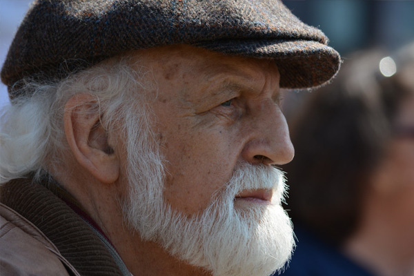 Older man with flat cap