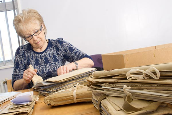 Lady looking through bundles of documents