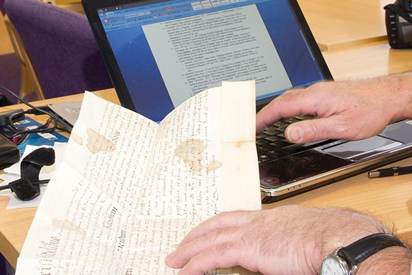 Historic papers and a laptop