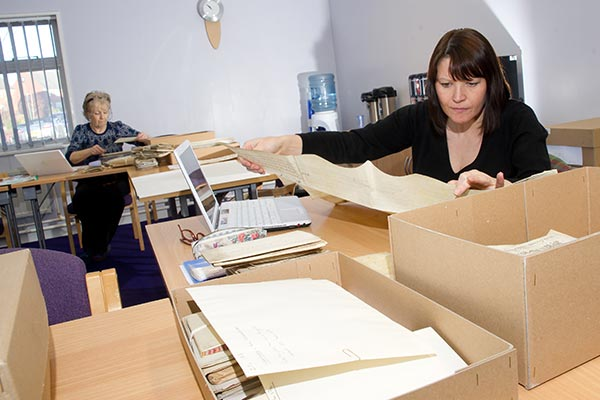 Lady sifting through historic documents