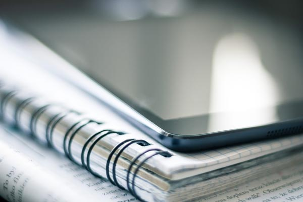 Notepad and ipad of minerals and waste plan