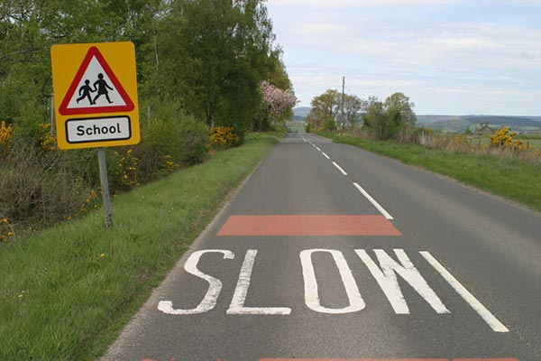 Safety sign and Slow road markings