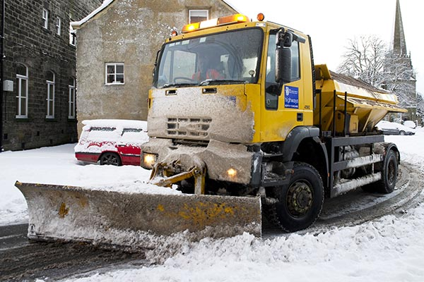 Gritter clearing snow