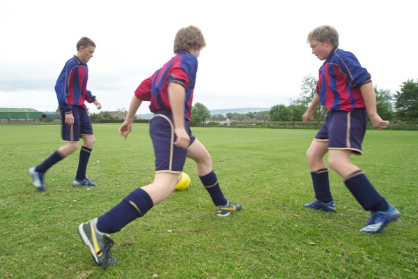 Students playing football at secondary school in North Yorkshire.