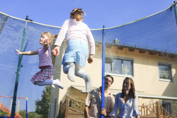 Children on trampoline with family in North Yorkshire.