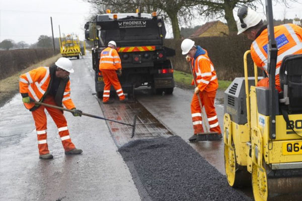 Highways workers working on local roads made possible with funding from government's local growth fund