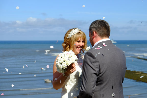 Couple Celebrating Their Marriage Near The Coast