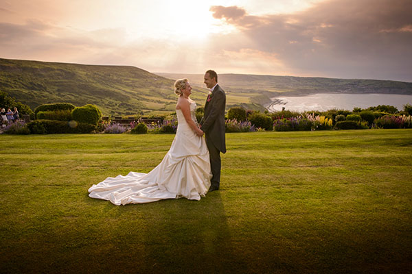 Married couple in the sunset at Raven Hall Country House Hotel.