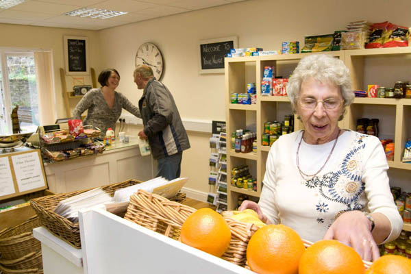Woman in shop in care home in North Yorkshire.