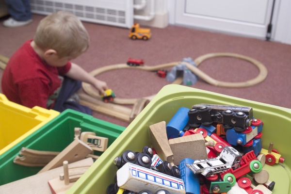 Child playing with train set at children's centre in North Yorkshire.