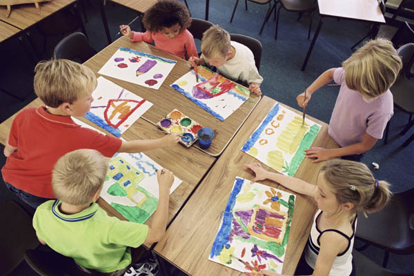 Children painting at children's centre in North Yorkshire.