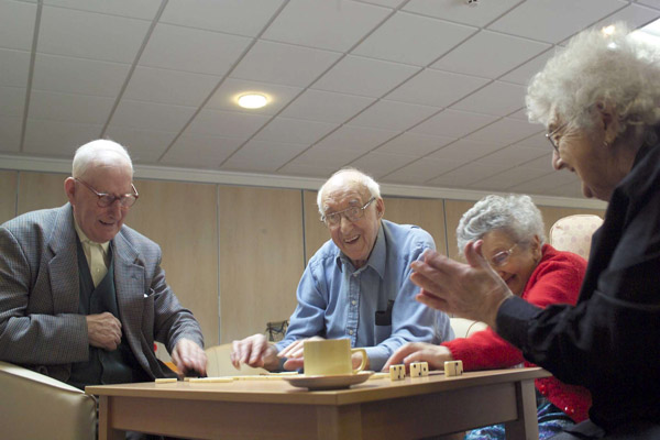 Couples playing a game in care home in North Yorkshire.