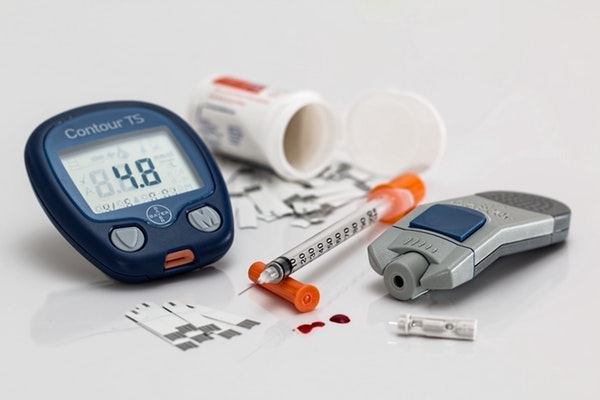 Blood sugar monitor, testing strips and insulin syringe for diabetic person in North Yorkshire.