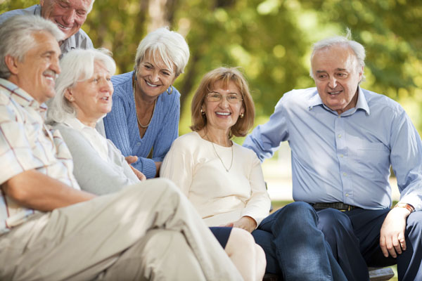 Group of older people sitting together outside in North Yorkshire.