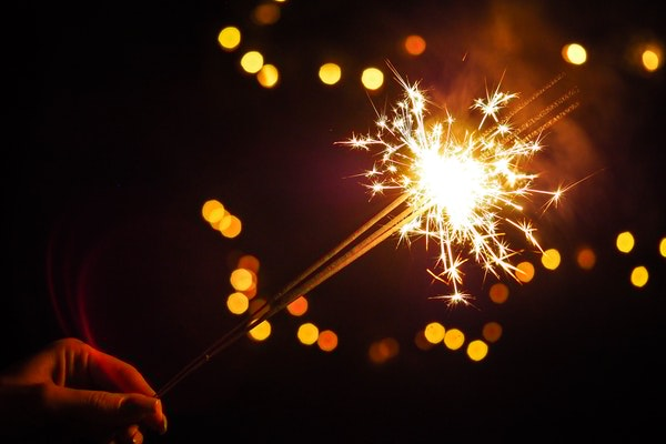 Person holding a sparkler at fireworks show in North Yorkshire.