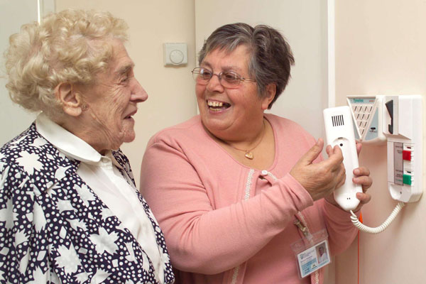 Care worker and older woman talking in North Yorkshire.