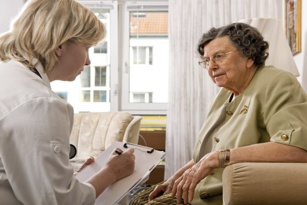 Older woman talking with health care provider in North Yorkshire.