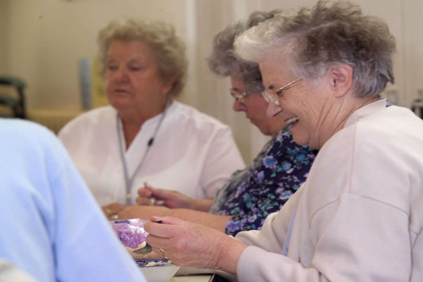 Older women sitting together in supported housing in North Yorkshire.
