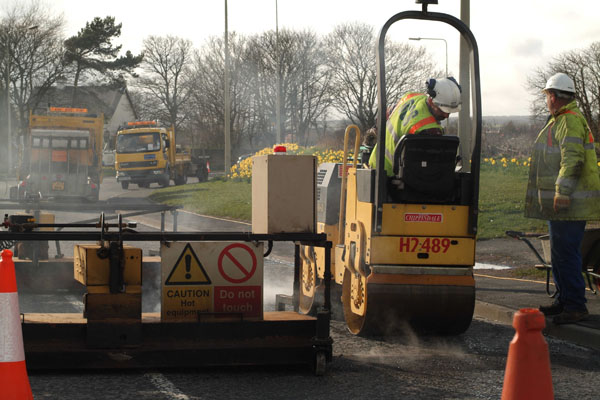 Contractor working on road construction project in North Yorkshire.