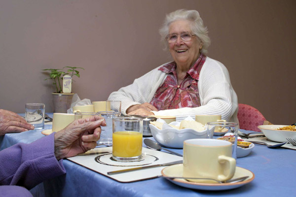 Woman eating in a care home in North Yorkshire.