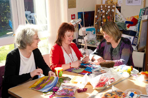 Women working on art project at community centre in North Yorkshire.